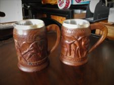 PAIR UNUSUAL CARVED WOODEN TANKARDS DIFFERENT ANIMALS + ALUMINIUM INSERT LINERS
